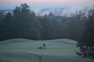 It's 7 a.m. on a Monday, and a Currahee Club worker shaves down the 9th green. (Note:  The club is closed on Tuesdays, not the traditional Monday.)